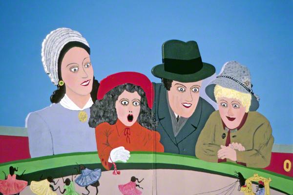 Das Bild einer Familie wirbt für den Flohzirkus auf dem Oktoberfest